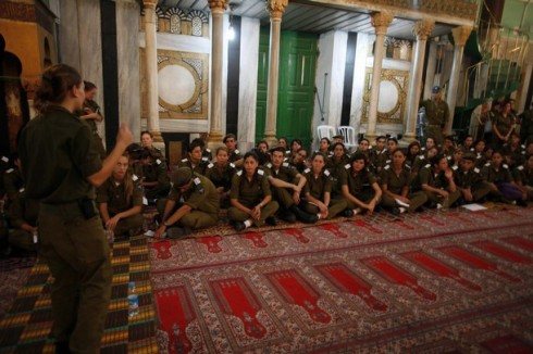 Israeli soldiers receive a lesson inside